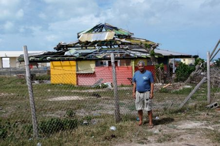 Richard In Front Of Damaged Building Burbuda